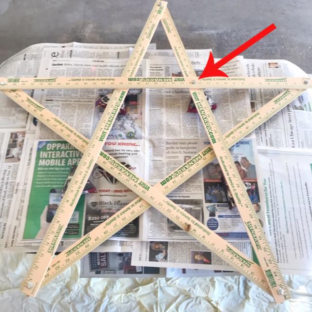 wooden yard stick newspaper