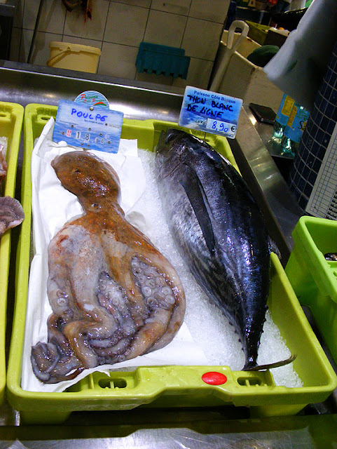 Octopus (Fr. poulpe) and line caught albacore tuna (Fr. thon blanc) at the fish market, Saint Jean de Luz. Pyrenees-Atlantiques. France. Photographed by Susan Walter. Tour the Loire Valley with a classic car and a private guide.