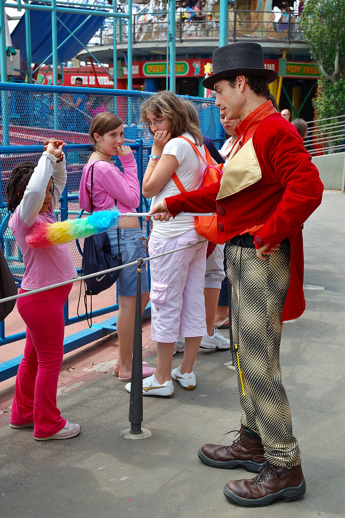Actor dusting a child's armpit during show at Tibidabo Amusement Park