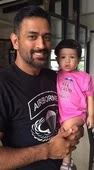 mahendra singh dhoni with her daughter