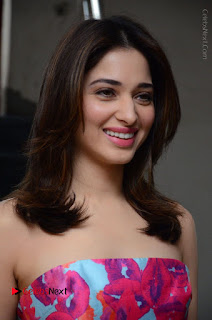 Actress Tamanna Latest Images in Floral Short Dress at Okkadochadu Movie Promotions  0010.JPG