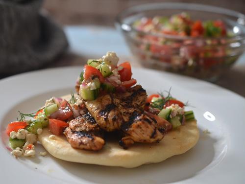 Grilled lemon oregano chicken pitas with Greek relish