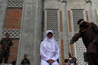 Young Indonesian couple flogged in public