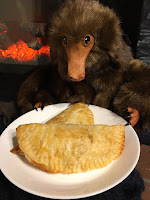 A homemade niffler holding a pumpkin pastie baked from The Unofficial Harry Potter Cookbook