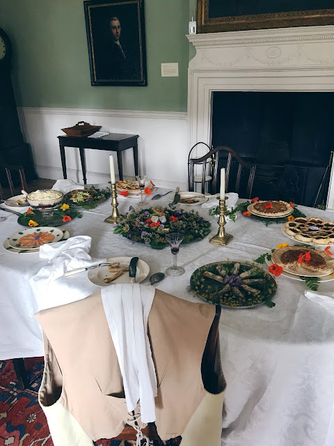 Table set with period cutlery and food
