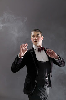 will young poses in a dinner suit as emcee in cabaret