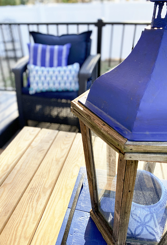 blue topped lantern and outdoor furniture