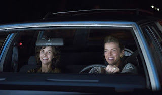 Cosmo Pfeil's wife Betty Gilpin driving car