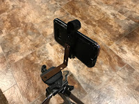 Phone attached to tripod