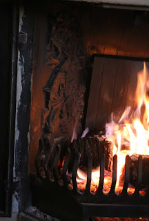 The cast patterns on the left of the fire