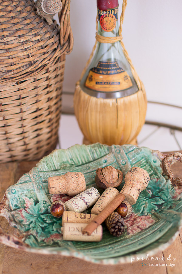 wine corks and pine cones in a bowl for fall decorating