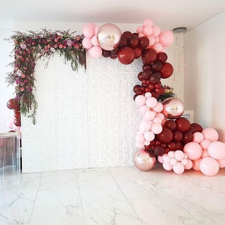 Greenery balloon arch and fresh flowers background decoration