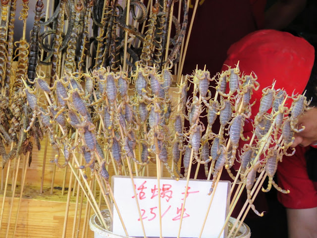 Scorpions on a stick spotted on Wanfujing Snack Street in Beijing China