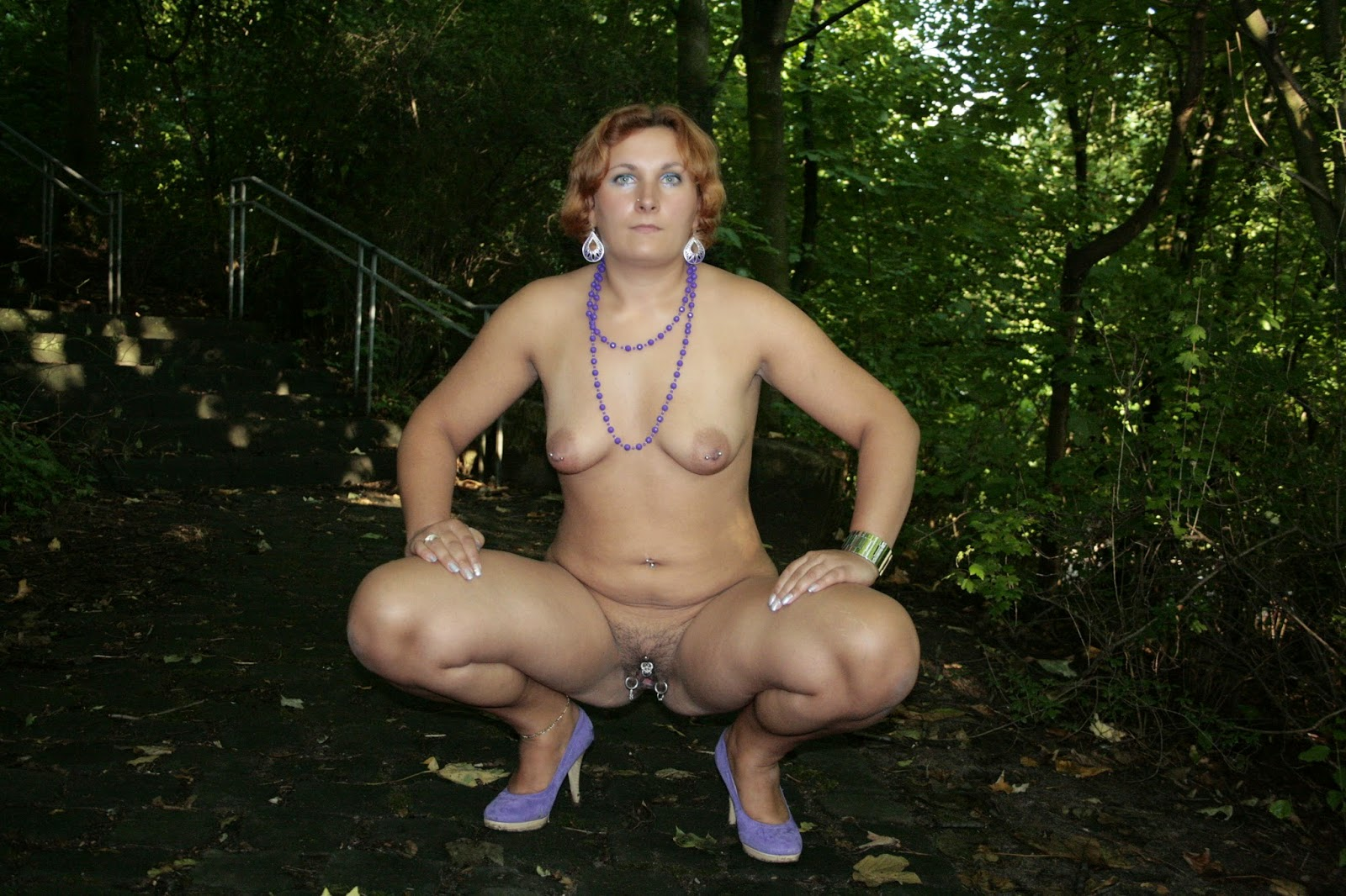 mature naked in forest