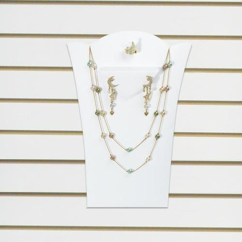 A slat wall-type jewelry display pad with a necklace, a pair of earrings, and ring displayed.