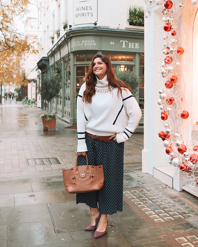 Striped sweater with polka dot pants and shoes