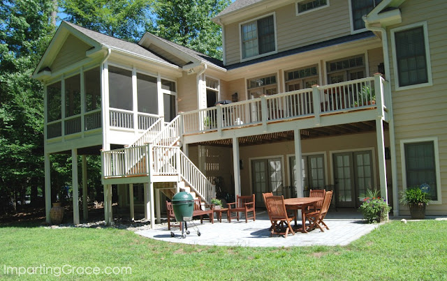Three-story house with ground level patio and second story deck and porch
