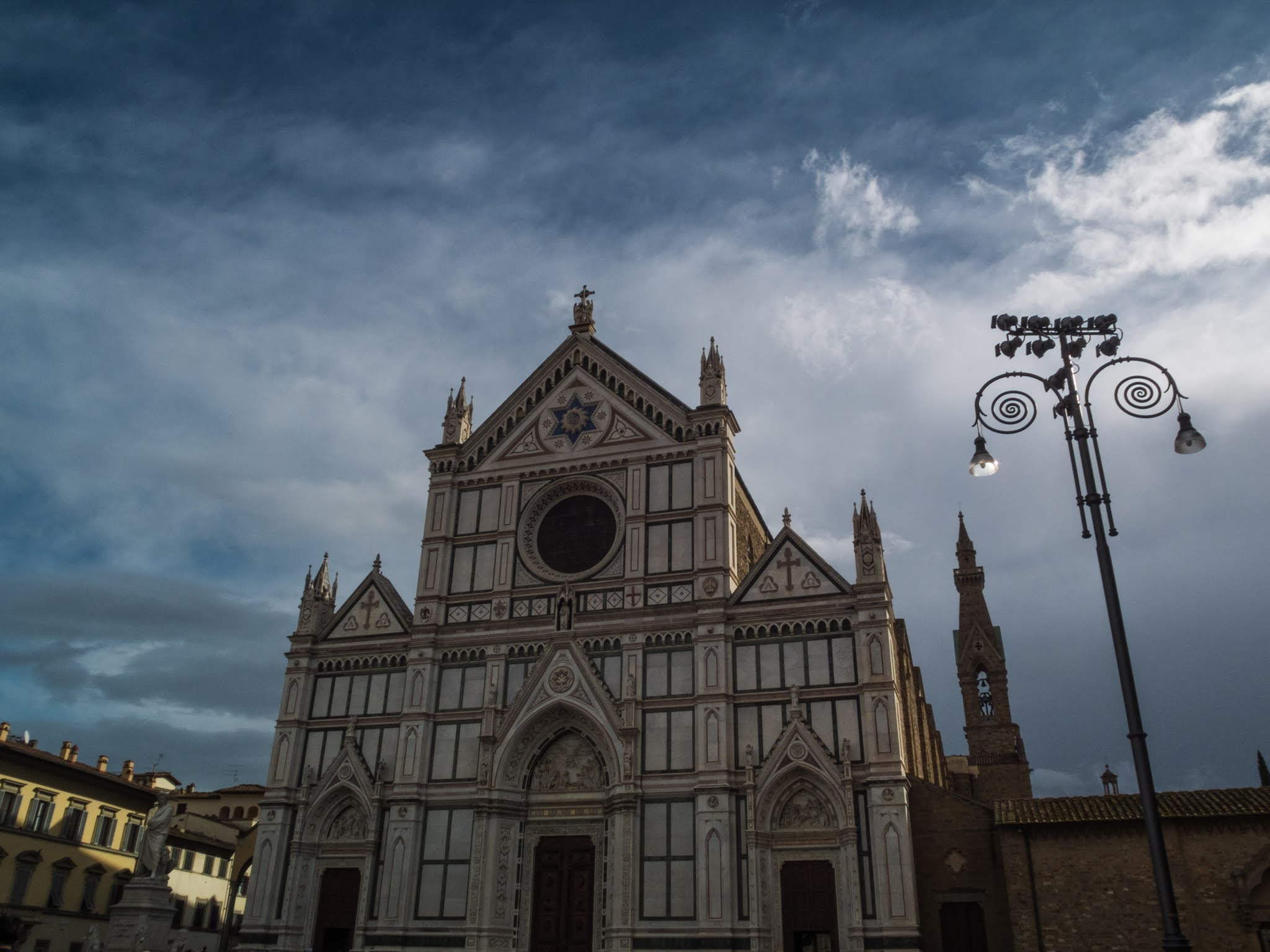 Basilica of Santa Croce and street lights in the piazza in Florence.