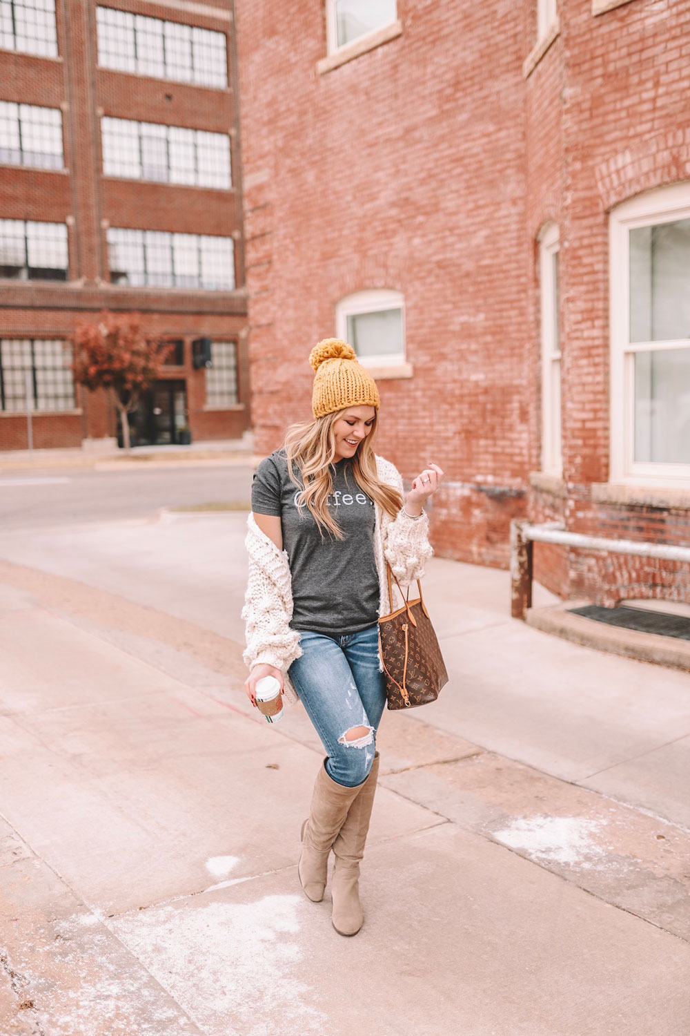 Oklahoma City blogger Amanda Martin sports a coffee graphic tee, a chunky cardigan and a yellow pom beanie.
