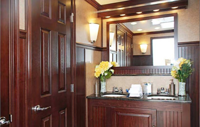 Vanity with Double Sink and Floral arrangement in Restroom Trailer
