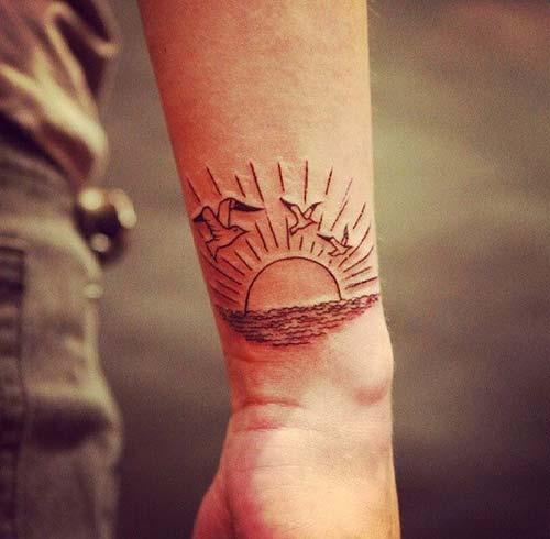 doğan güneş dövmesi bilek rising sun tattoo on wrist
