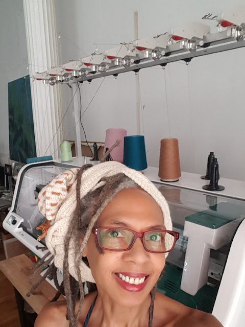 Olgalyn Jolly in front of Kniterate knitting machine