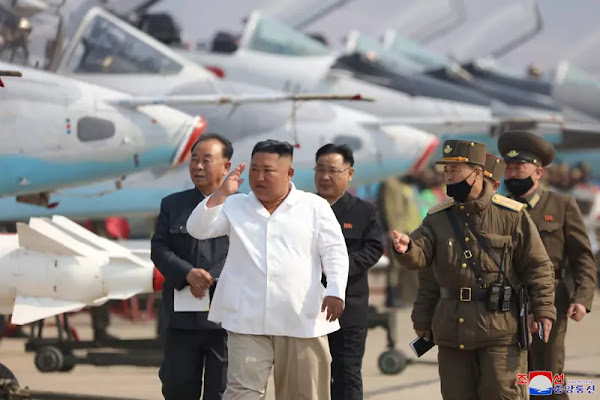 Kim Jong Un inspects pursuit assault plane group