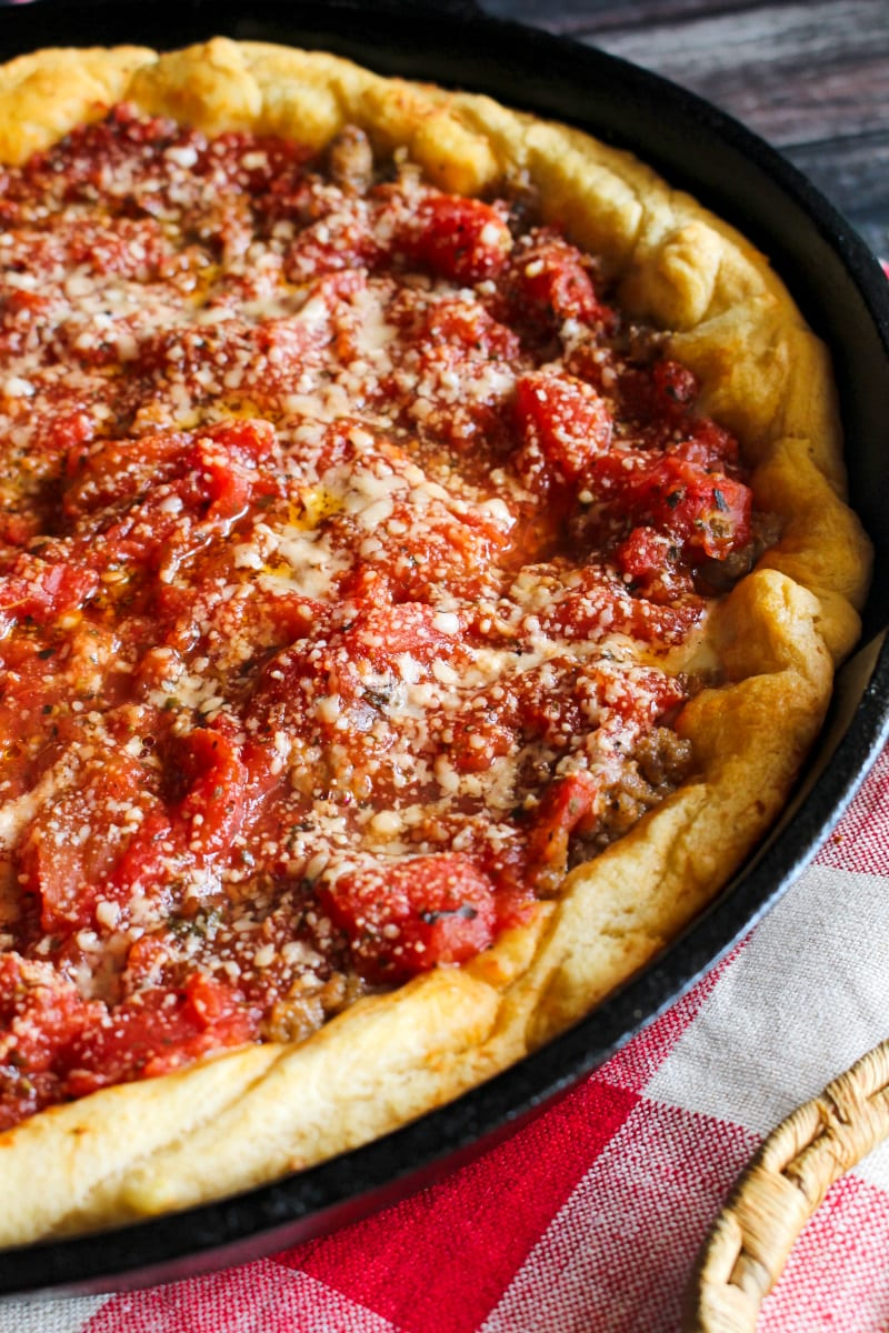 This Crescent Roll Deep Dish Pizza is a fun twist on a classic Chicago-style pie. The crescent rolls make a delicious and easy shortcut crust for this tasty deep dish pizza! #pizza #crescentrolls
