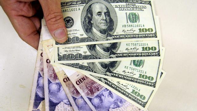 É melhor usar pesos argentinos ou dólares na Argentina?