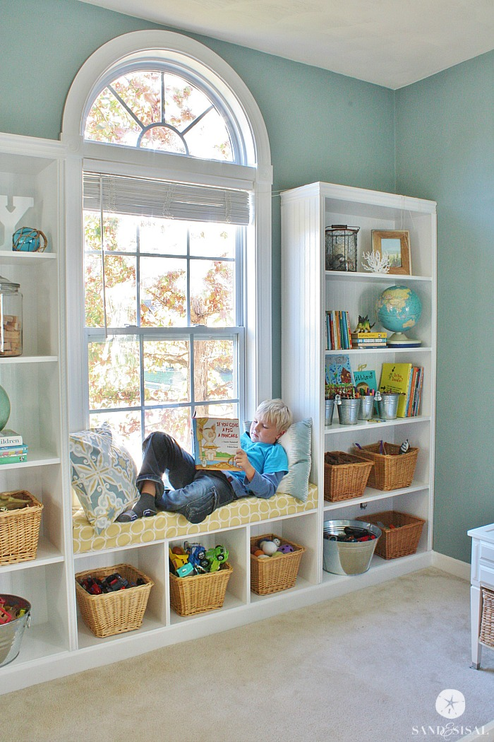 Built in bookcases and seat around window