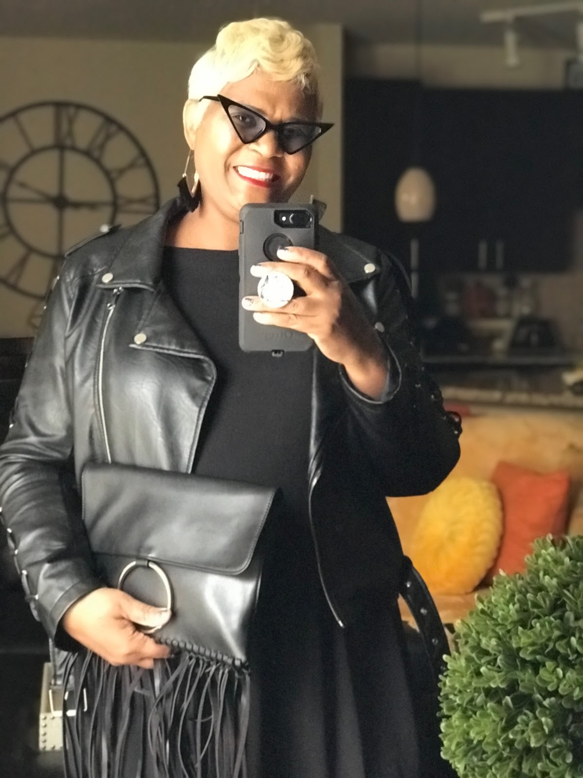 Tangie Bell is sharing her fringe clutch with all black outfit before heading out to DIY shop for sales and make jewelry