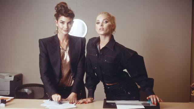 Women in suits at desk