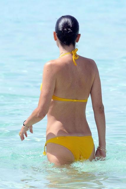 Jennifer Connelly in Yellow Bikini at a Beach in Ibiza