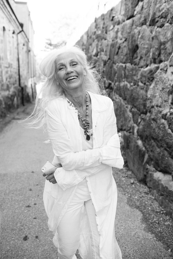 image result for laughing midlife woman with grey hair in white