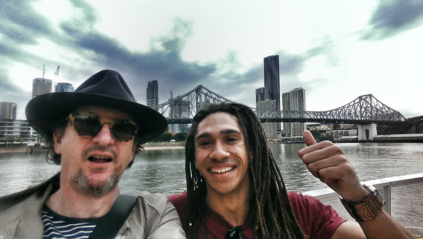The autor and friend on the take a selfie on the riverside walkway New Farm with the city and Storey Bridge in the background. Photo by Kent Johnson.