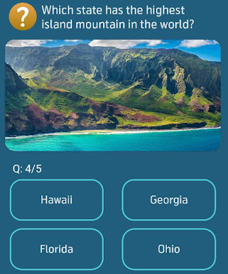 Which state has the highest island mountain in the world?