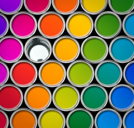 paint canisters filled with colorful paint