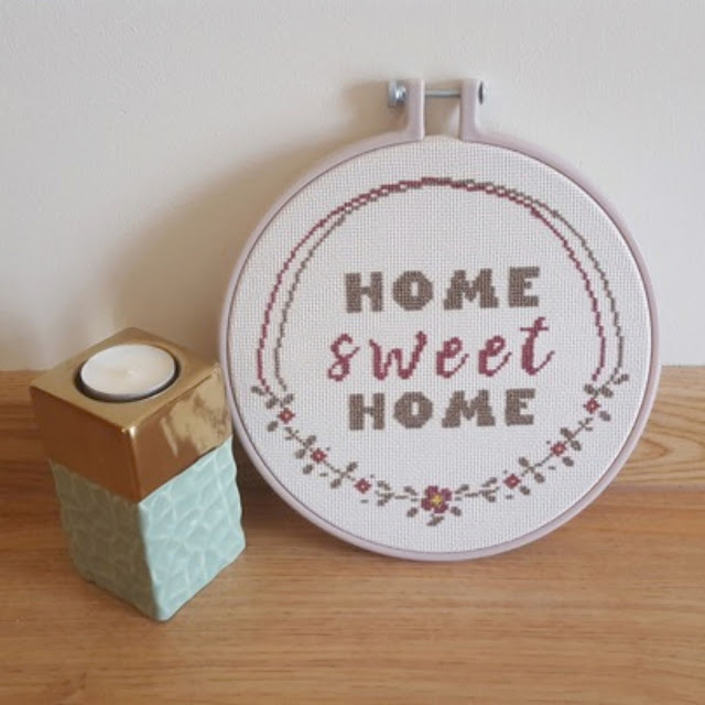 Home Sweet Home cross stitched sign