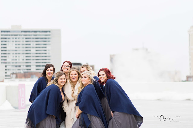 bridesmaids on rooftop at z belt lot smiling