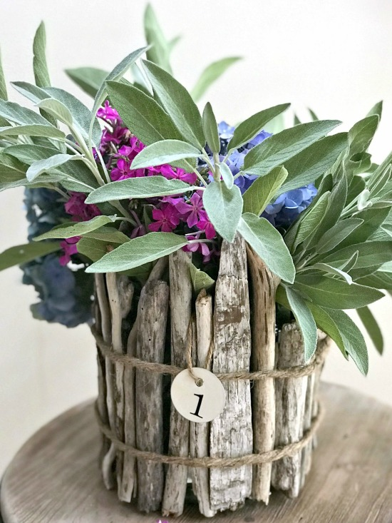 DIY Driftwood vase for flowers with metal hang tag and flowers