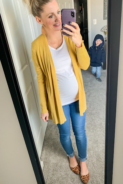Yellow cardigan with jeans and leopard slip-ons