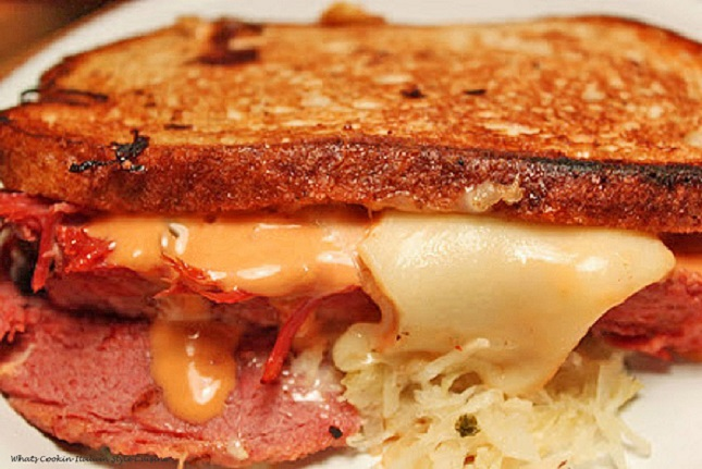 rye bread with sauerkraut swiss cheese, thousand island dressing corned beef grilled