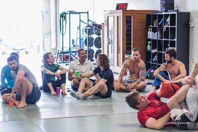 Students converse and train at Dark Clan Brew Jitsu 2021.