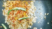Sauteeing chopped onion with spices and slits green chili for paneer masala recipe