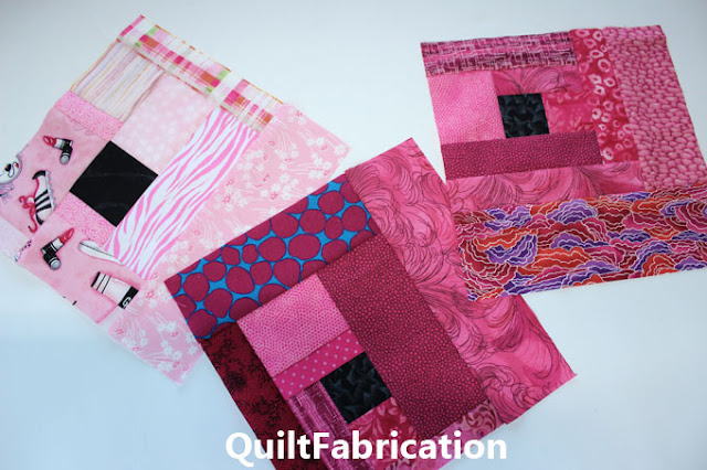 dark pink and light pink scrappy quilt blocks