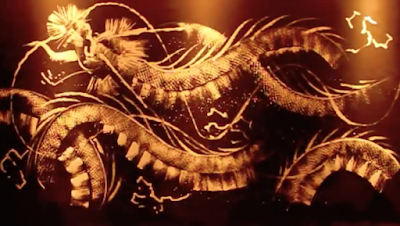 Video of the paining of a golden dragon by Takeshi Sato
