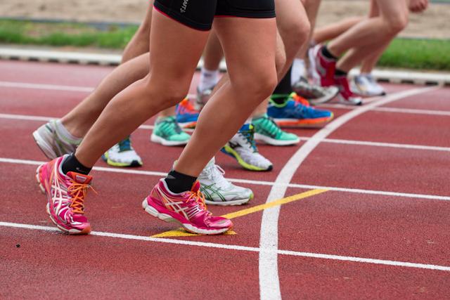 Athletic Women Running On Track