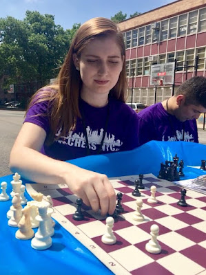 Rebecca Brett playing chess