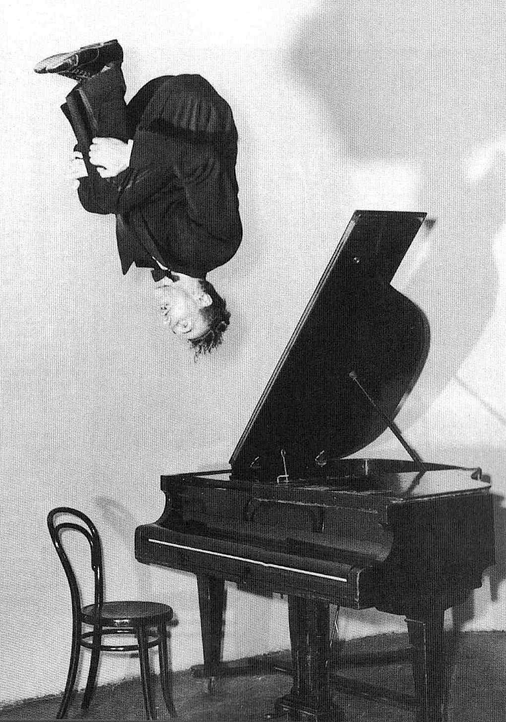 Jerry Lee Lewis jumping from his piano in a photograph, the killer