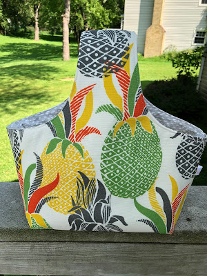 bag made of colorful pineapple fabric